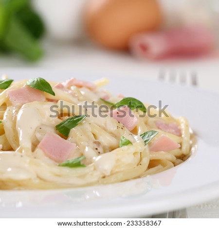 Spaghetti Carbonara noodles pasta meal with ham on a plate - stock photo