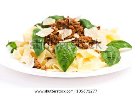 Spaghetti carbonara on white plate with basil - stock photo