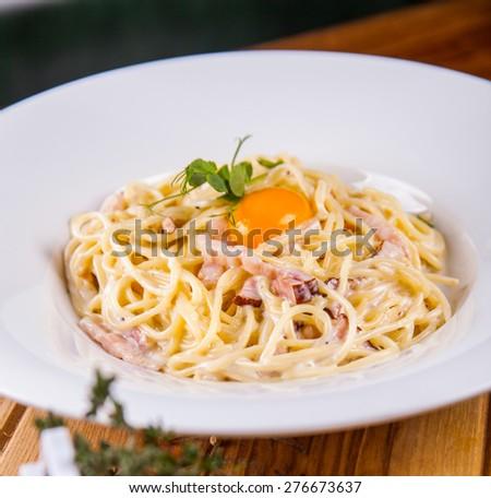 Spaghetti Carbonara with bacon and cheese - stock photo