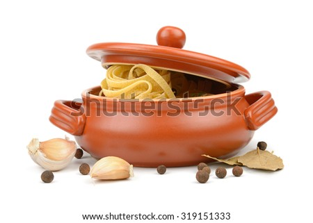 Spaghetti in a clay pot isolated on white - stock photo