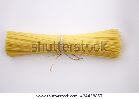 spaghetti on the whit background - stock photo
