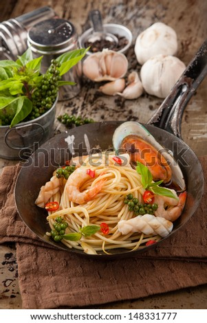 Spaghetti Seafood of topped with shrimp. - stock photo