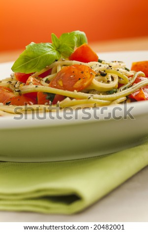 Spaghetti with cherry tomatoes on the table - stock photo
