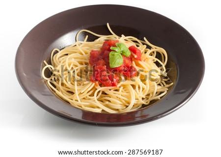 spaghetti with fresh tomato and basil - stock photo