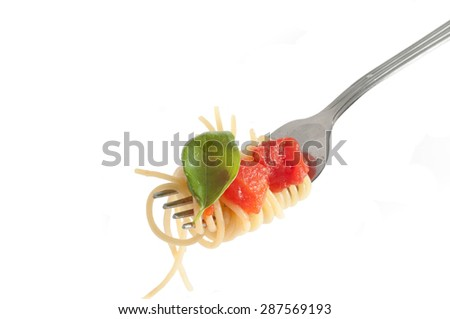Spaghetti with fresh tomato rolled on fork. Traditional Italian Food - stock photo