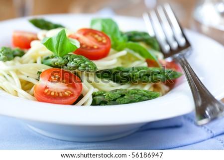 Spaghetti with green asparagus - stock photo