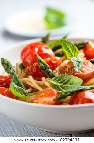 Spaghetti with Green Asparagus and Cherry Tomatoes - stock photo
