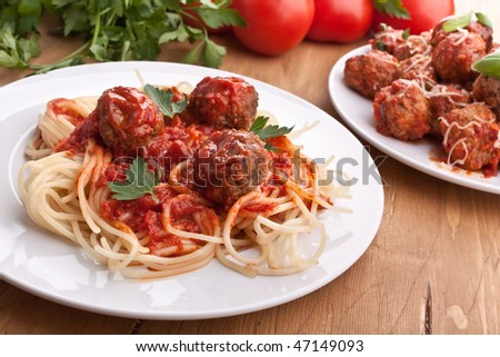 spaghetti with  meatballs in tomato sauce on a plate - stock photo