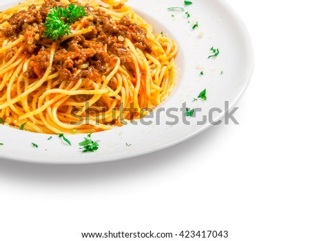 spaghetti with minced meat and sauce (bolognese) on a plate on white background - stock photo