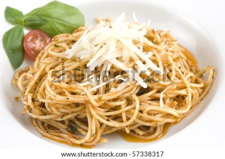 Spaghetti with mozzarella cheese, tomato and basil - stock photo