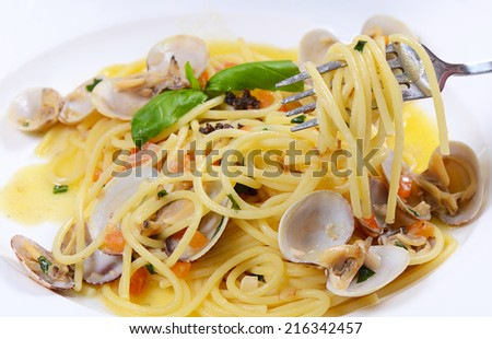 Spaghetti with mussels in bowls close up - stock photo
