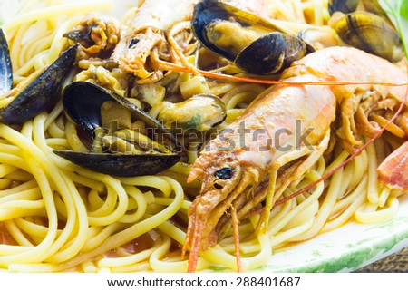 Spaghetti with prawns and mussels - stock photo