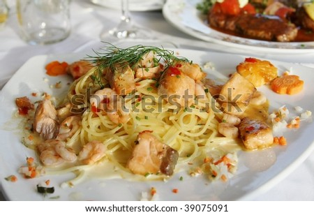 Spaghetti with Scampi and Salmon in Garlic sauce - stock photo