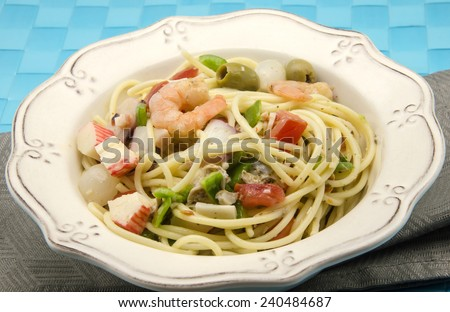 Spaghetti with seafood salad served on a plate - stock photo