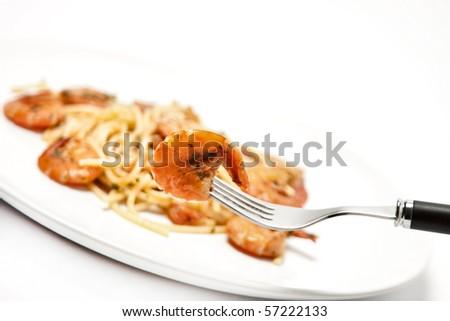 spaghetti with tomato sauce and shrimps - stock photo