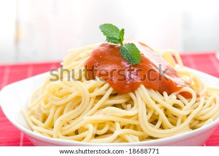 spaghetti with tomato sauce on white bowl - stock photo