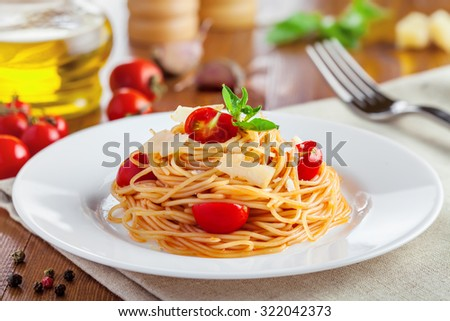 Spaghetti with tomato sauce, parmesan cheese and basil, delicious Italian food - stock photo