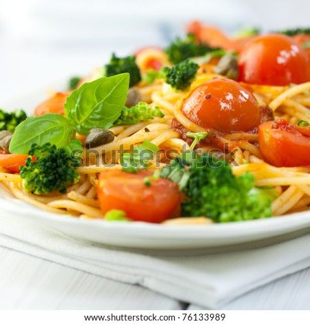 Spaghetti with vegetables and capers - stock photo