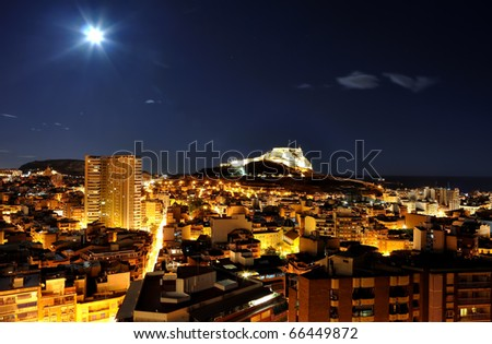 Spain, Alicante at night with castle - stock photo