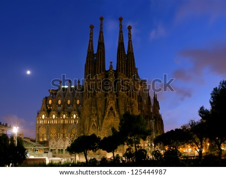 SPAIN - AUGUST 24: La Sagrada Familia in night - cathedral designed by Antoni Gaudi, which is being build since 1882 and is not finished yet August 24, 2012, in Barcelona, Spain. - stock photo