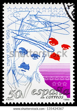 SPAIN - CIRCA 1989: a postage stamp printed in Spain showing an image of Charles Chaplin, circa 1989. - stock photo