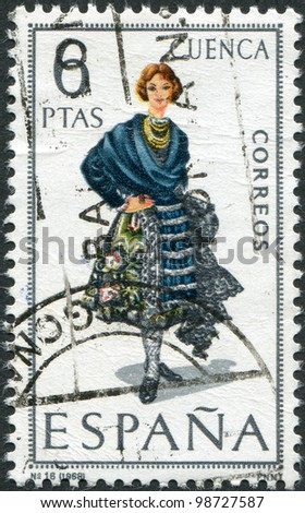 SPAIN - CIRCA 1968: A stamp printed in Spain, shows a woman in folk dress of the region Cuenca, circa 1968 - stock photo