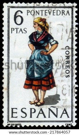 Spain - CIRCA 1970: A stamp printed in Spain, shows girl in pontevedran costume, Pontevedra, spanish city in the north-west of the Iberian Peninsula, circa 1970 - stock photo