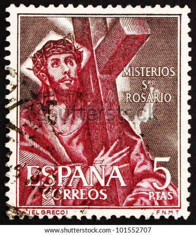 SPAIN - CIRCA 1961: a stamp printed in the Spain shows Jesus Christ Carrying Cross, circa 1961 - stock photo