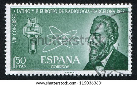 SPAIN - CIRCA 1967: stamp printed by Spain, shows W. K. Roontgen, X-ray Tube and Atom, circa 1967 - stock photo