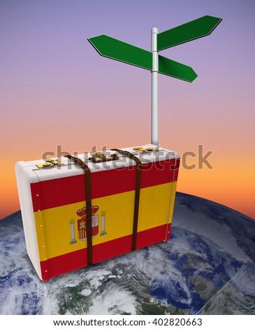 Spain flag suitcase against sunrise sky - stock photo