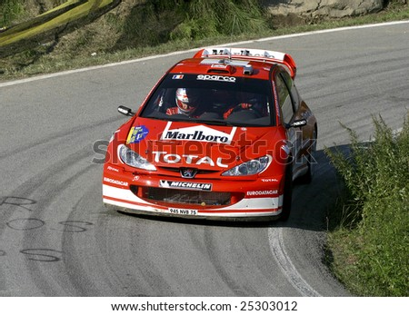 Spain, november 2: Gilles Panizzi with Peugeot on 2 November 2003 during the Rally Catalunya-Costa Brava of World Championship - stock photo