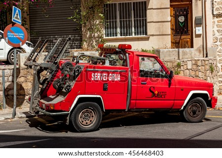 Spain Palm de Mallorka of June 20 Red car with crane for emergency and maintenance service  June 20, 2016 in Palm de Mallorka Spain - stock photo