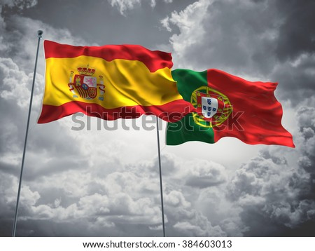 Spain & Portugal Flags are waving in the sky with dark clouds - stock photo