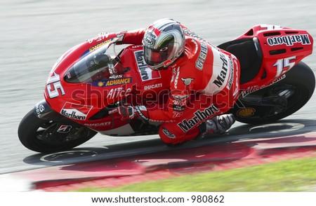 Spain's MotoGP rider Sete Gibernau takes a corner during a 2006 pre-season test at Sepang International Circuit, Malaysia. - stock photo