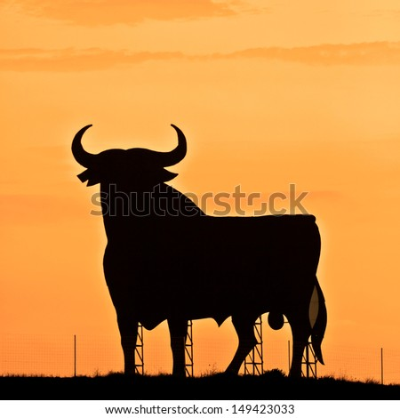 Spain,silhouette of a bull in the field in Andalusia. - stock photo