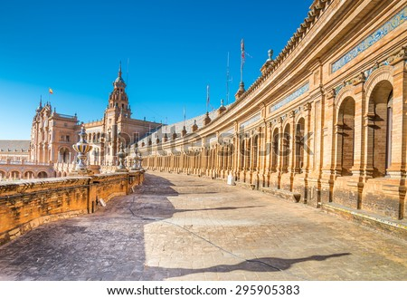 Spain Square (Plaza de Espana) is in the Public Maria Luisa Park, in Seville. It is a landmark example of the Renaissance Revival style in Spanish architecture. - stock photo