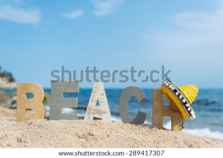 Spanish beach with landscape and Sombrero - stock photo