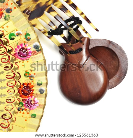 spanish castanets, peineta and hand fan on a white background - stock photo