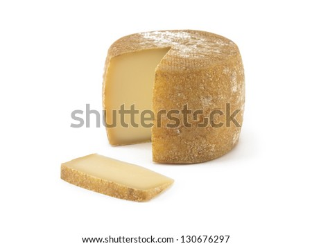 Spanish cheese with a portion isolated on white - stock photo