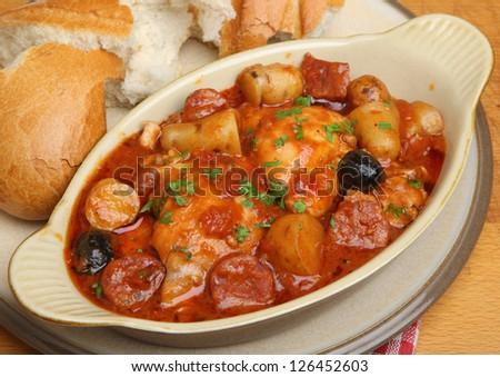 Spanish chicken casserole with chorizo and new potatoes. - stock photo