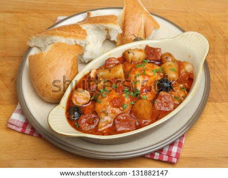 Spanish chicken casserole with chorizo, new potatoes and olives. - stock photo