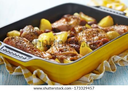 Spanish chicken casserole with mini chorizo and potatoes. - stock photo