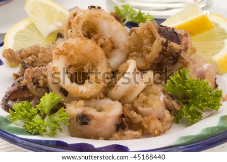 Spanish cuisine. Andalusian deep-fried squids. Chipirones a la andaluza. Selective focus. - stock photo