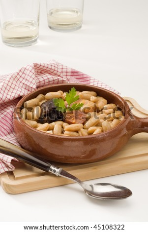 Spanish Cuisine. Fabada asturiana. Asturian ham and beans. Selective focus. white background. - stock photo