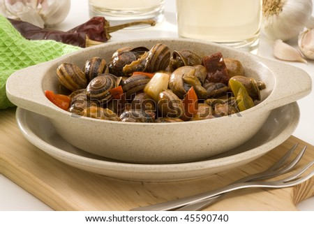 Spanish cuisine. Snails in sauce. Selective focus. Caracoles en salsa. - stock photo