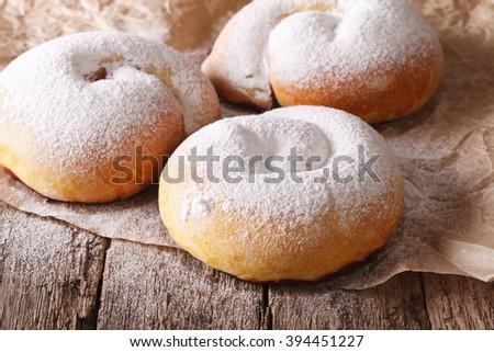 Spanish ensaimadas sweet rolls with powdered sugar close-up on the table. horizontal - stock photo
