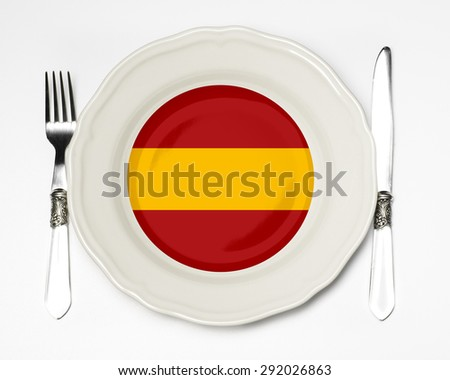 Spanish flag on a plate - stock photo