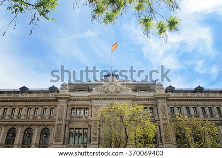 Spanish flag over the library of Madrid - stock photo