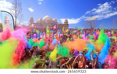 Spanish Fork, Utah, USA. 3/28/15. Throwing color at the Krishna color festival - stock photo