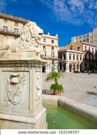Spanish fountain in the San Francisco Square in Old Havana , a touristic landmark famous for its colonial architecture in Old Havana - stock photo